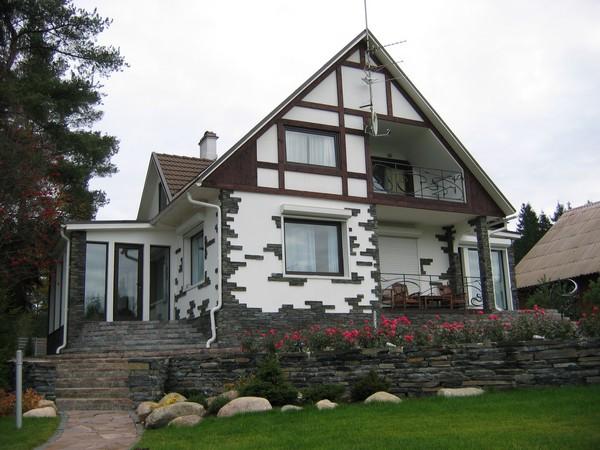 чем отделать фасад частного дома: натуральный камень фото